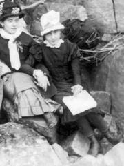 Elizabeth Gibson [Cheyne], holding her teacher's hand