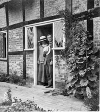 Wilfrid and Geraldine at the door of their cottage, 1914.