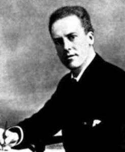 Portrait of Karl Pearson seated, writing.