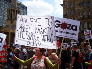 "Antiwar banner, "" An eye for an eye makes the whole world blind"", on Gaza protest, London 2014. Photo by Judy Greenway"