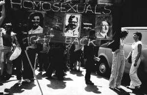 Protesters carrying banner with slogan 'homosexuals fight back', and images linking Anita Bryant, Mary Whitehouse and Adolf Hitler.