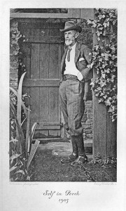 'Edward Carpenter outside his home at Millthorpe, 1905. He is bearded and sandalled, and in an informal pose. The image is titled 'Self in Porch'.