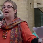 Clara Connolly of Women Against Fundamentalism, speaking at a Protest the Pope demonstration in London. From a photo by Helen Lowe.