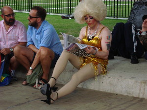 Tattooed drag queen reads a socialist paper while waiting for a Downing Street protest, part of a Global Speakout on homophobia in Russia,  2013.
