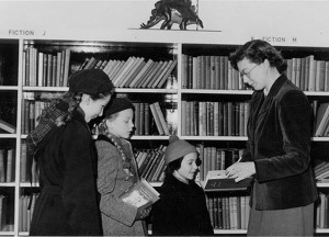 Me, clutching a book, at the opening of a new children's library around the time of writing the letter to my grandfather circa 1956