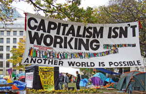 banner on site of Occupy London, 2011. 'Capitalism isn't working. Another world is possible'. Photo by Judy Greenway.