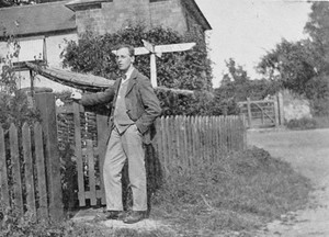 Wilfrid Gibson, around 1913, standing outside his house near Dymock.