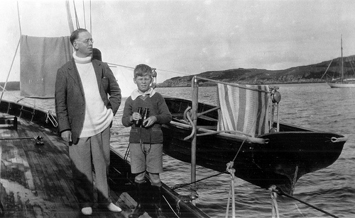Wilfrid with the eleven-year-old Michael on the deck of the Sea Swallow.
